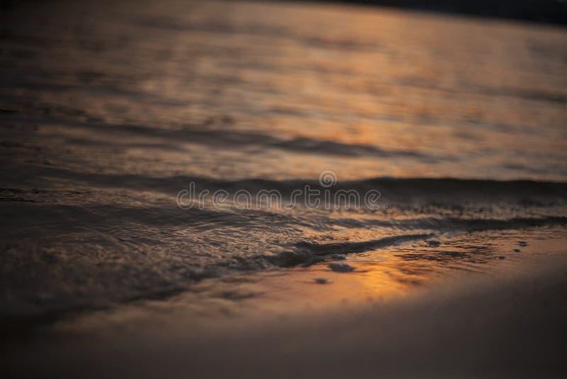 Вода в заходе солнца стоковые изображения