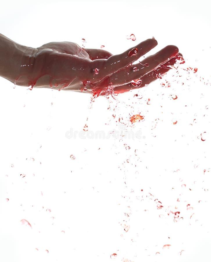 вода руки красная брызгая стоковые изображения