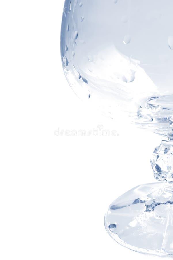 вода тона голубых капек чашки стеклянная стоковое изображение