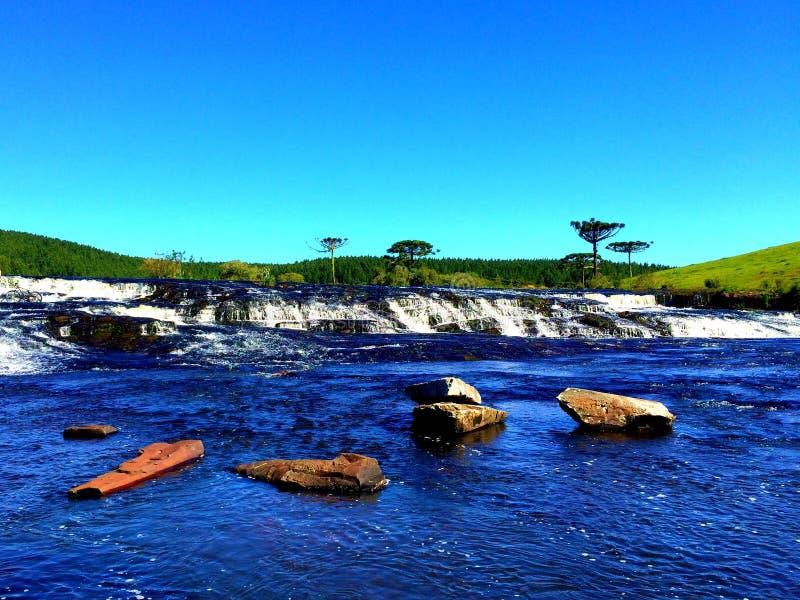 Водопад в полях стоковое фото rf