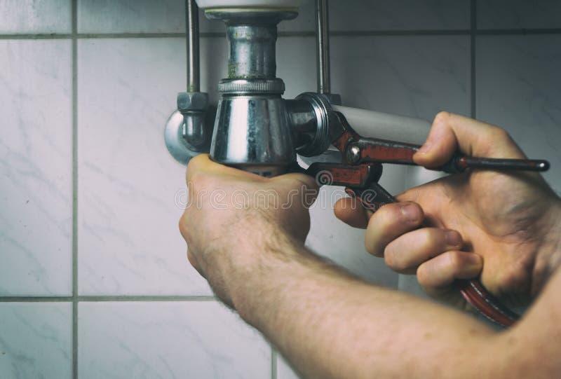 водопроводчик стоковая фотография