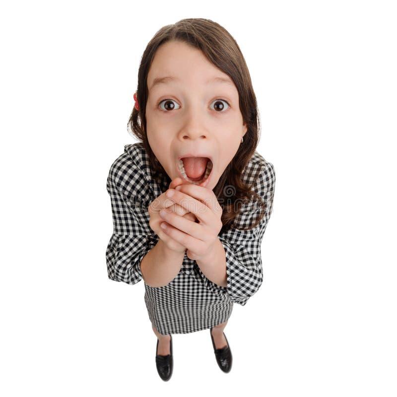 Возбужденная маленькая девочка на белизне стоковое фото rf