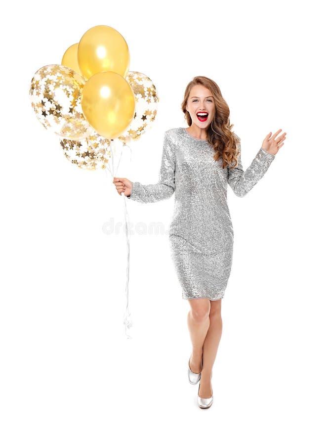 Возбужденная молодая женщина с воздушными шарами на белой предпосылке стоковая фотография rf