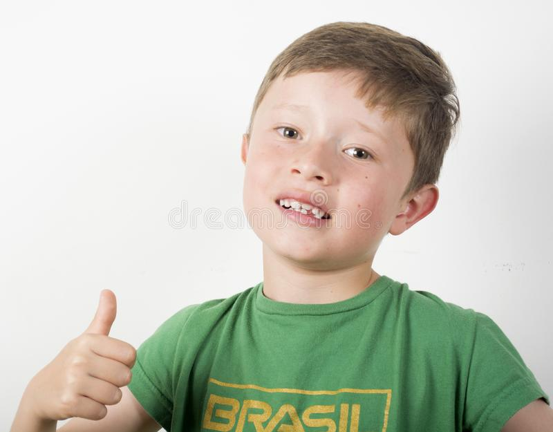 Возбужденный футболист мальчика стоковое изображение
