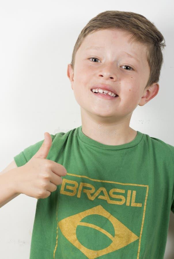 Возбужденный футболист мальчика стоковое изображение rf