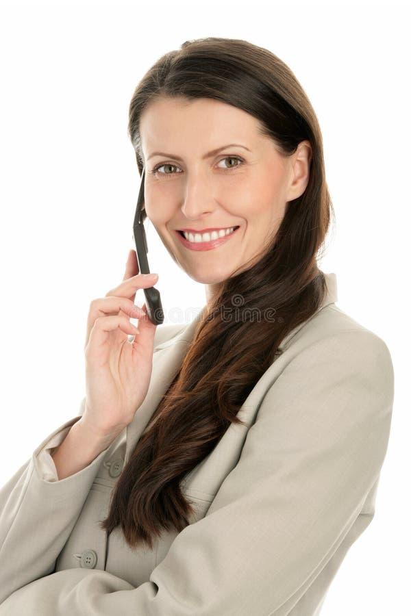 возмужалая женщина мобильного телефона стоковое фото rf