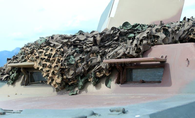 Воинская тележка с шестерней камуфлирования для полетов войны стоковое изображение rf