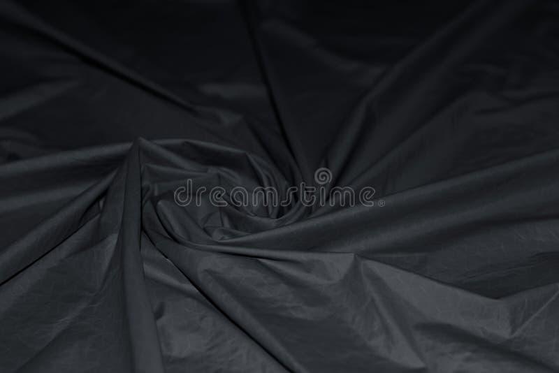 Волнистая спираль складывает ткани нейлона grunge Абстрактная предпосылка ткани водоустойчивого высококачественного материала ней стоковая фотография rf