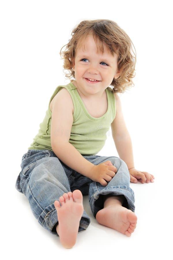 волосы глаз сини младенца курчавые милые стоковые фото