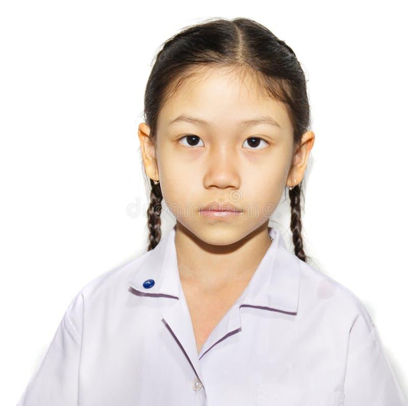волосы девушки изолировали белизну маленькой студии школы зрачка trifling равномерную стоковая фотография rf