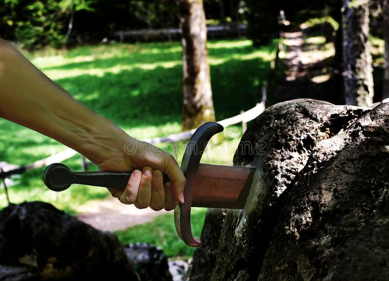 Волшебная шпага Excalibur и рука стоковое изображение