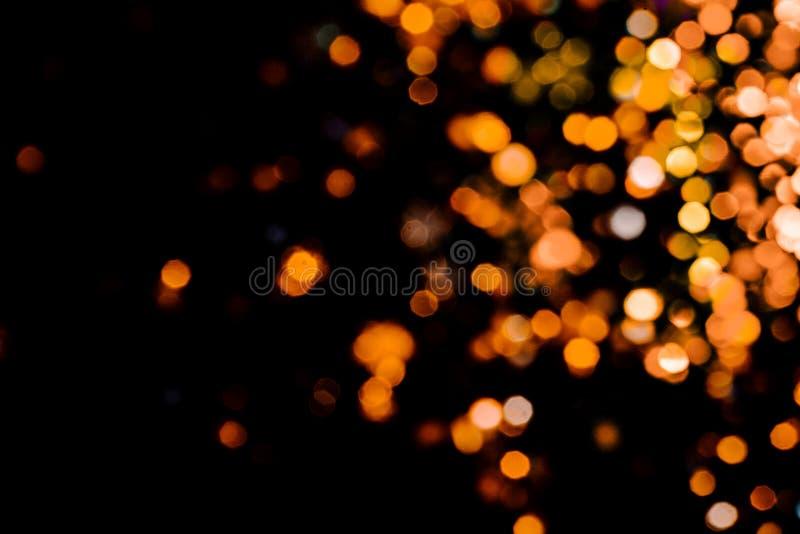 Волшебное bokeh рождества светов на черной предпосылке стоковое фото
