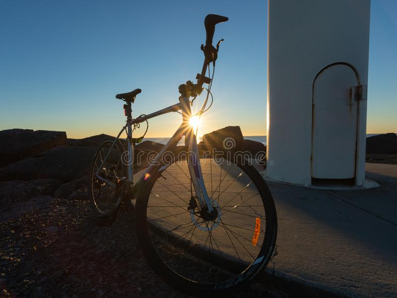 Восходящая вспышка за велосипедом стоковые изображения