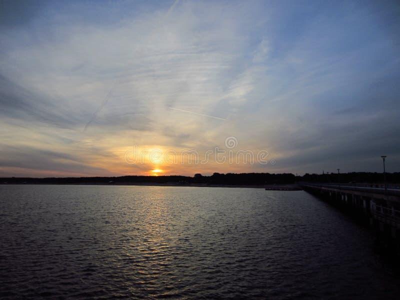 Восход солнца морем лета стоковое фото
