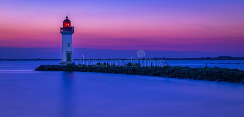 Восход солнца на маяке стоковые изображения