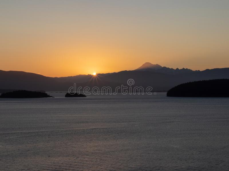 Восход солнца на накидке Sante Вашингтоне anacrotes стоковое изображение rf