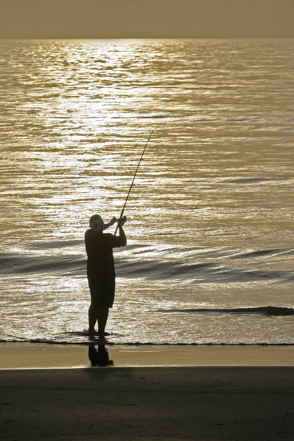 восход солнца рыболова стоковое изображение rf