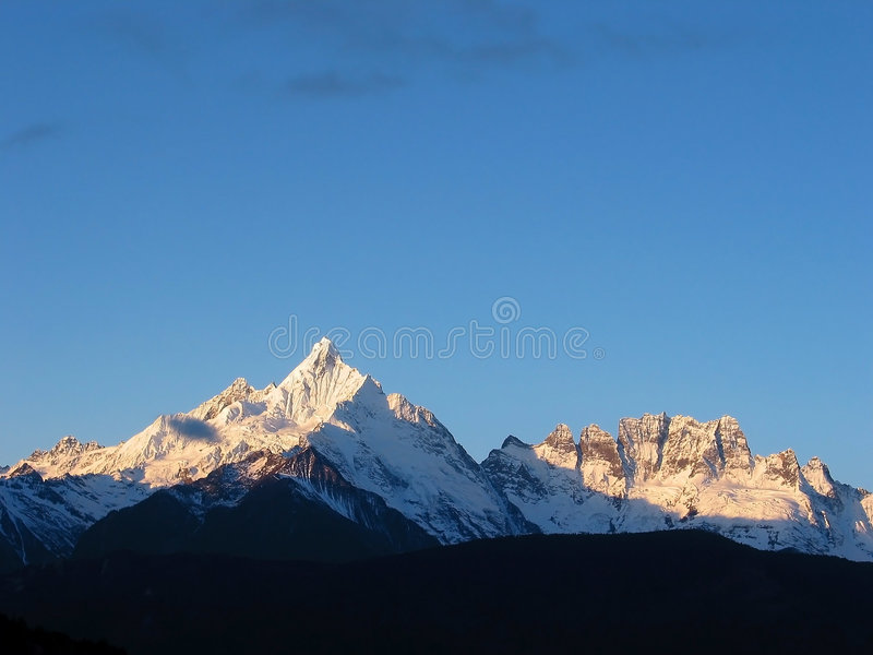 восход солнца снежка горы meili стоковые изображения