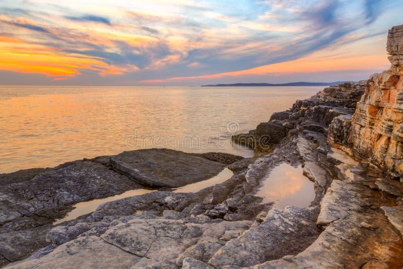 Восход солнца над морем около Rt Kamenjak стоковые изображения