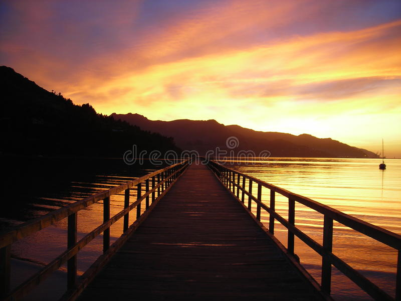 Восход солнца на пристани стоковая фотография