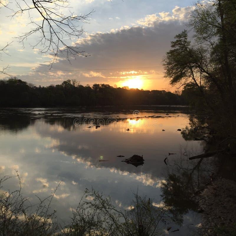 восход солнца на реке стоковое фото rf