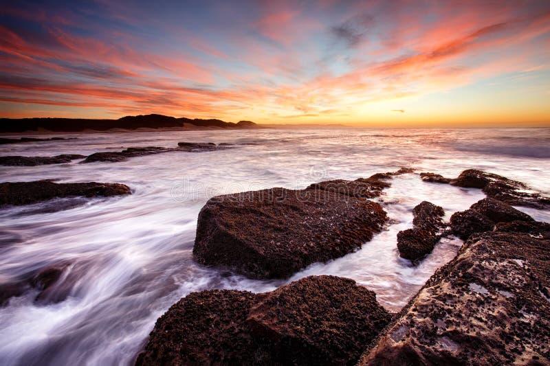 Восход солнца пляжа Kidds стоковое изображение