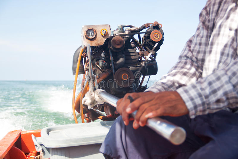 Водитель шлюпки на море стоковое фото rf