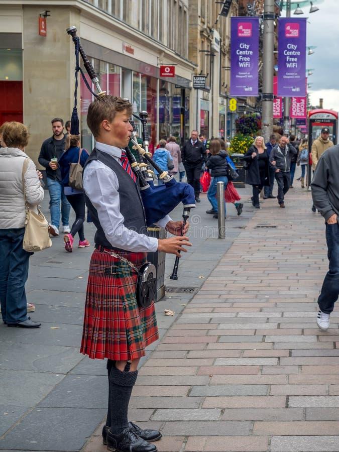 Волынщик, улица Buchanan, Глазго стоковая фотография rf