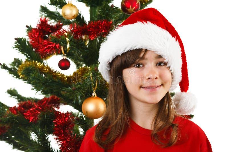 Время рождества - девушка с шляпой Санта Клауса стоковое фото rf