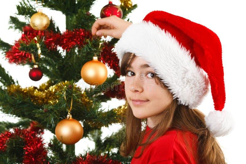 Время рождества - девушка с шляпой Санта Клауса стоковое фото