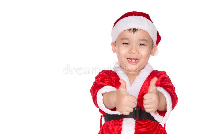 Время рождества - мальчик с шляпой Санта Клауса Молодой мальчик как Cl Санты стоковые изображения rf
