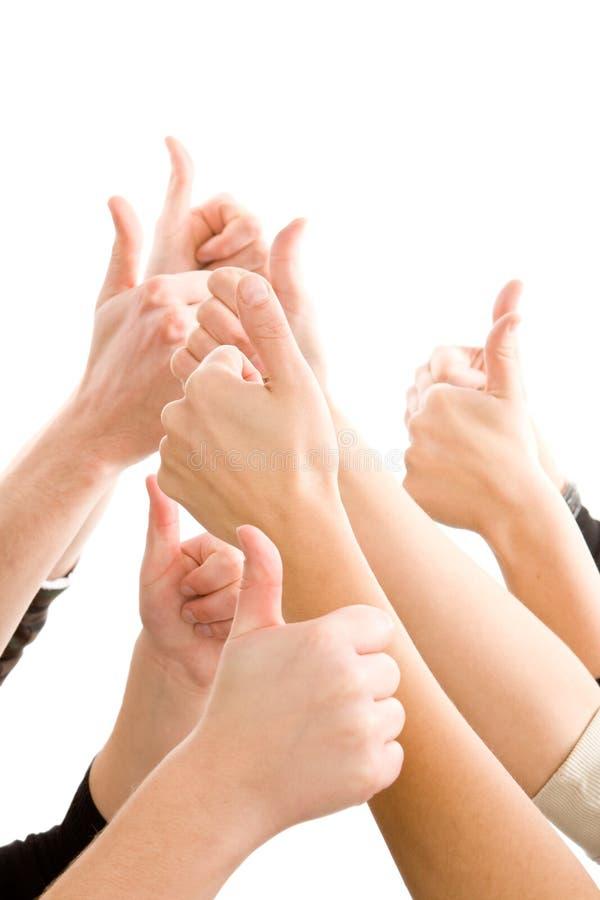 вручает человека показывая большие пальцы руки вверх стоковое изображение rf