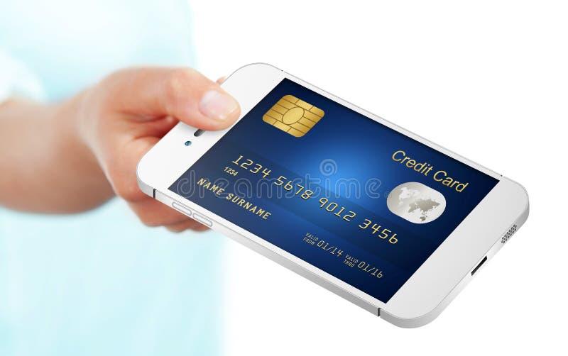 Вручите держать мобильный телефон при кредитная карточка изолированная над белизной стоковые фотографии rf
