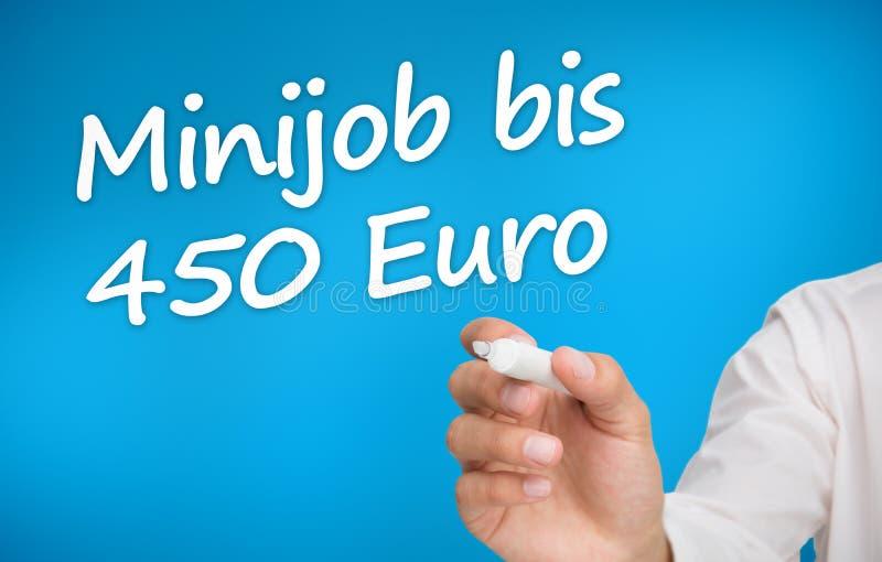 Вручите сочинительство с евро bis 450 minijob отметки стоковая фотография