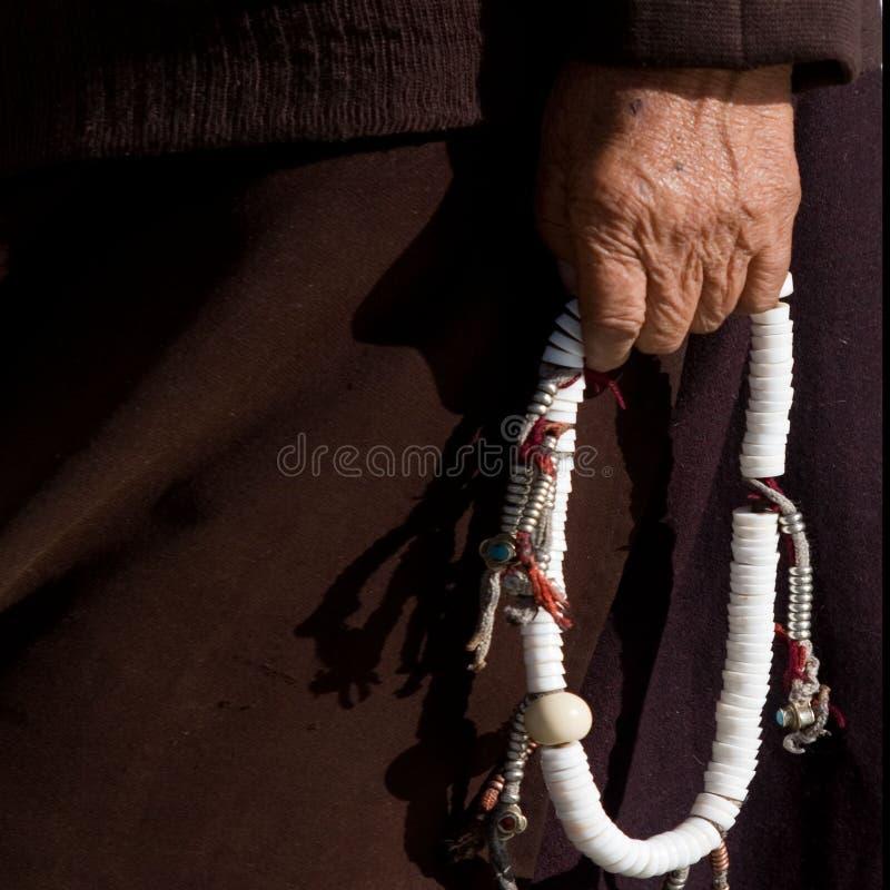 вручите тибетца стоковое изображение rf