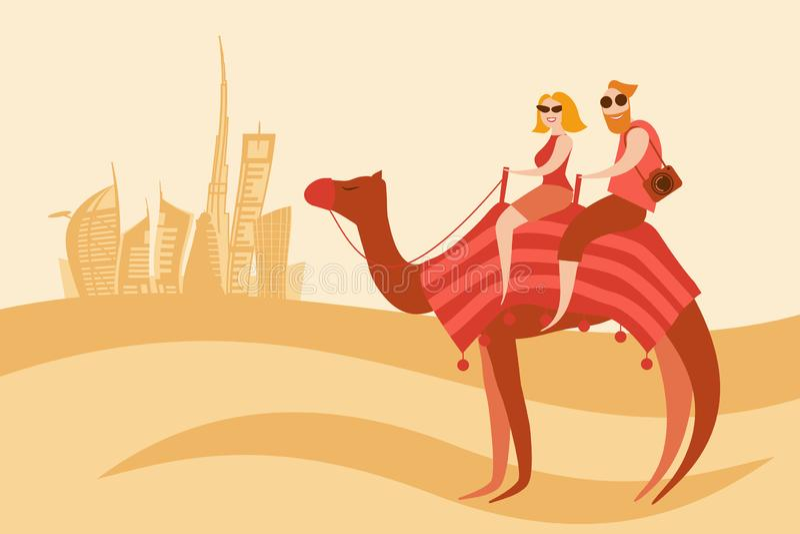 Всадники верблюда пар туристов в пустыне около города Дубай стоковые изображения