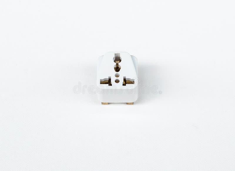Всеобщий штепсель на белом холсте стоковое изображение rf