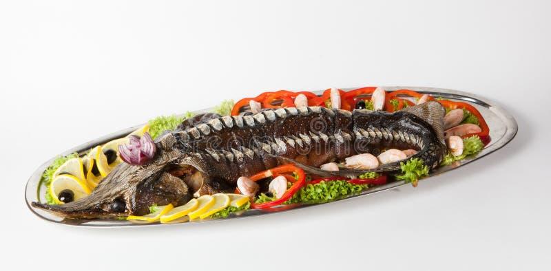 Все испеченные рыбы стерляжины стоковые фотографии rf
