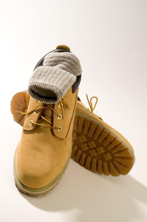вскользь неровные ботинки стоковое фото rf