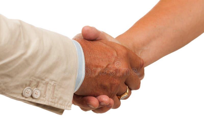 Встряхивание руки между человеком и женщиной стоковая фотография