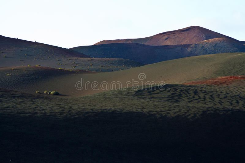 Download Вулканический ландшафт в национальном парке Стоковое Фото - изображение насчитывающей защищено, flatland: 40589480