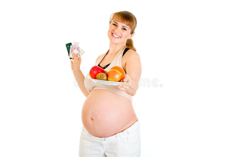 выбирать женщину здорового уклада жизни супоросую сь стоковое фото rf
