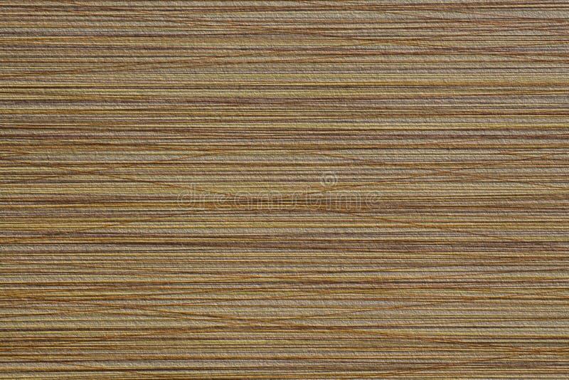 Выбитая поверхность коричневого цвета текстуры с хаотическими нашивками стоковая фотография rf