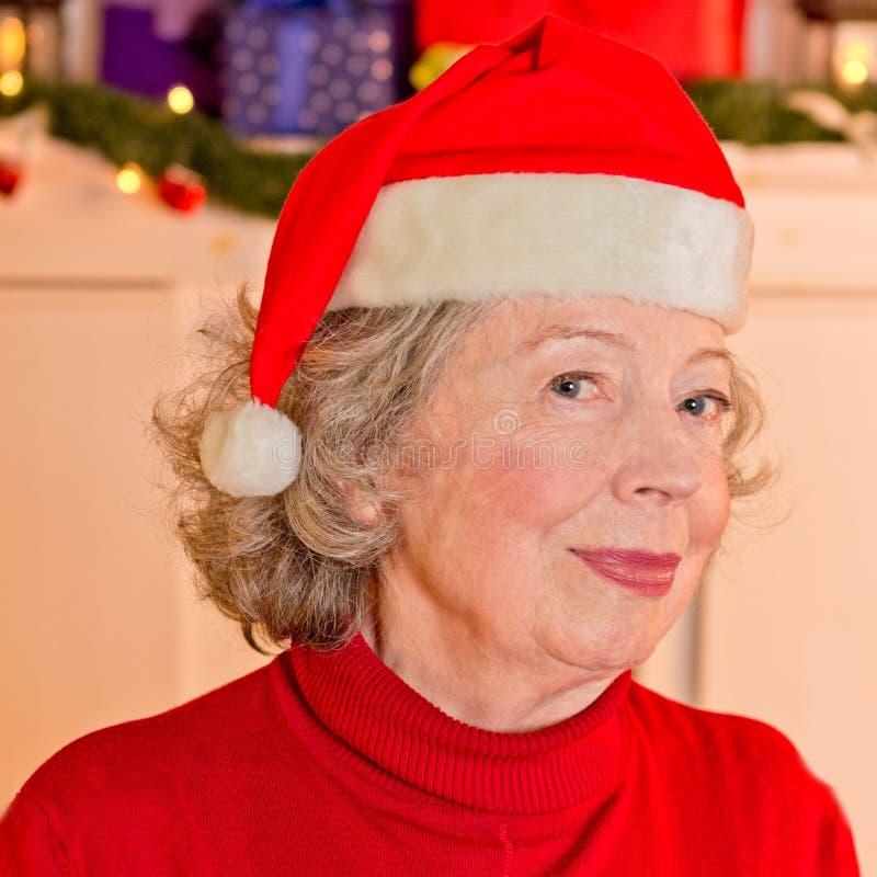 Выбытая шляпа рождества отца женщины стоковое изображение
