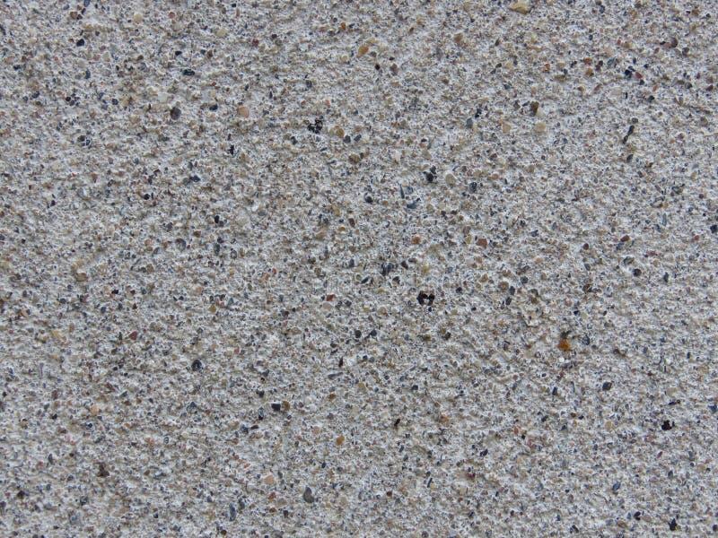 Выдержанная бетонная стена с штукатурить Серая предпосылка бетонной стены гравия цемента стоковые фото