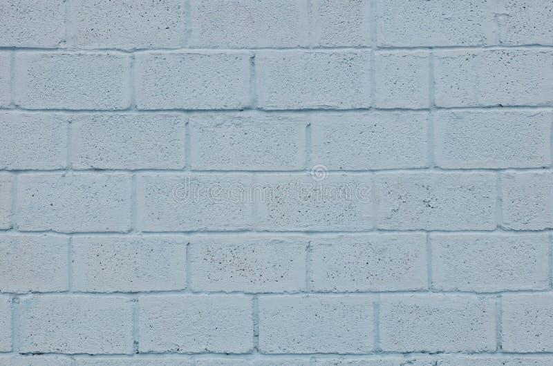 Выдержанная и запятнанная покрашенная голубая текстура стены блока стоковое изображение