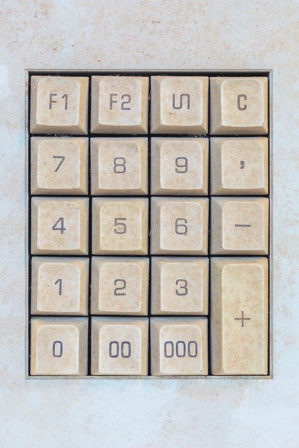Выдержанная кнопочная панель компьютера с кнопками номера стоковая фотография