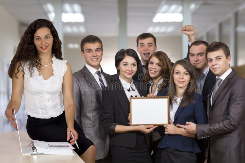Выигрывая команда корпоративного бизнеса и красивый стоковое фото