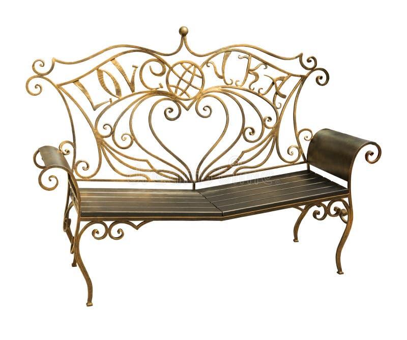 Выкованная скамейка в парке при богато украшенная картина изолированная на белом backgrou стоковая фотография rf