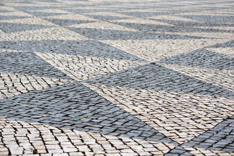 Вымощенная дорога в Лиссабоне, Португалии стоковое фото rf
